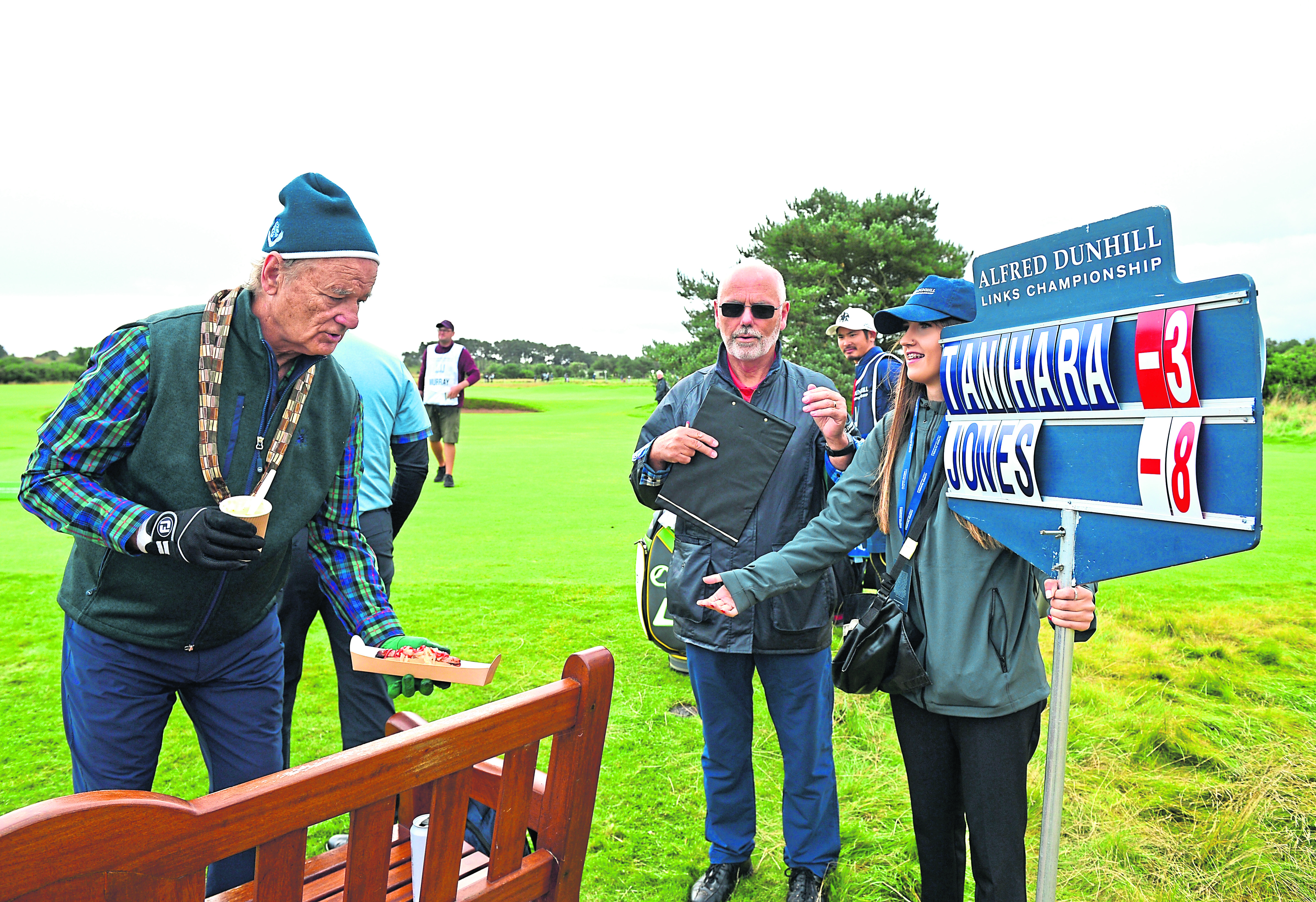 Bill Murray hands the scorer a hot dog during Day two of the Alfred Dunhill Links Championship at Carnoustie.