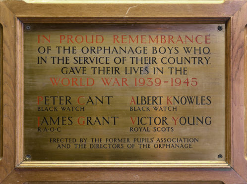 The memorial in the McManus to the four men.