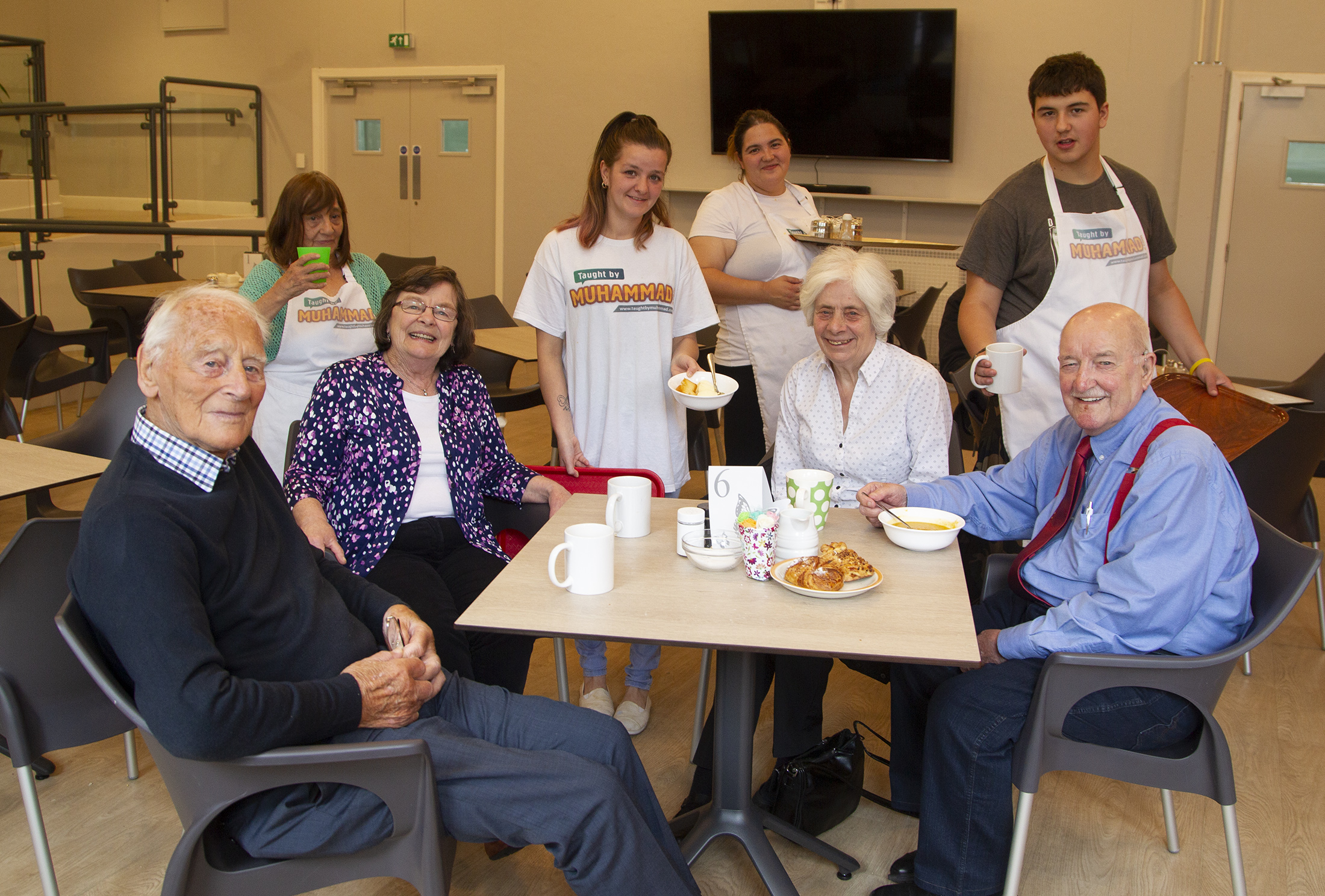 At Douglas Community Centre customer (seated L to R) Noel Patrick, Shirley Gibson Elizabeth Sinclair James Young  being served by staff (L to R) Edith Hawkins Lesley Ann Bruce Amanda Oudney. Gareth Hathway