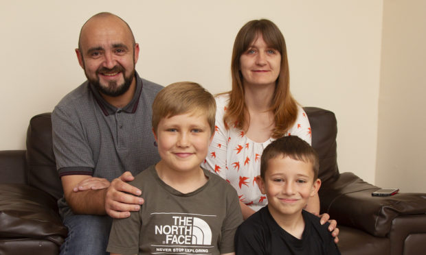 Aiden Marshall, 11 (left) pictured at home in Montrose with his mum Theresa, Dad Jon and brother Callum,(10).