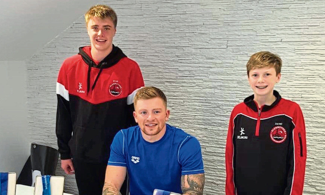 Glenrothe ASC members Ryan King (left) and David Smyth  got to meet their hero Olympic and World Champion Adam Peaty at a swim clinic in Cumbria.