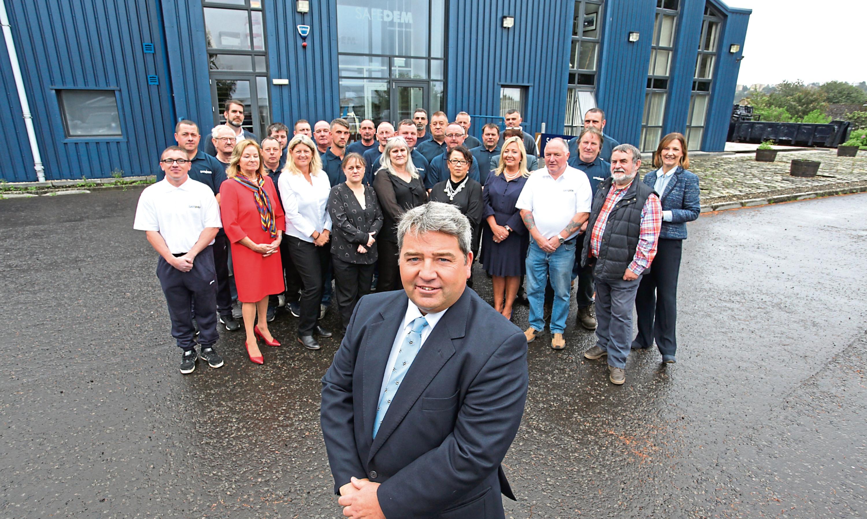 Managing director William Sinclair with Safedem staff