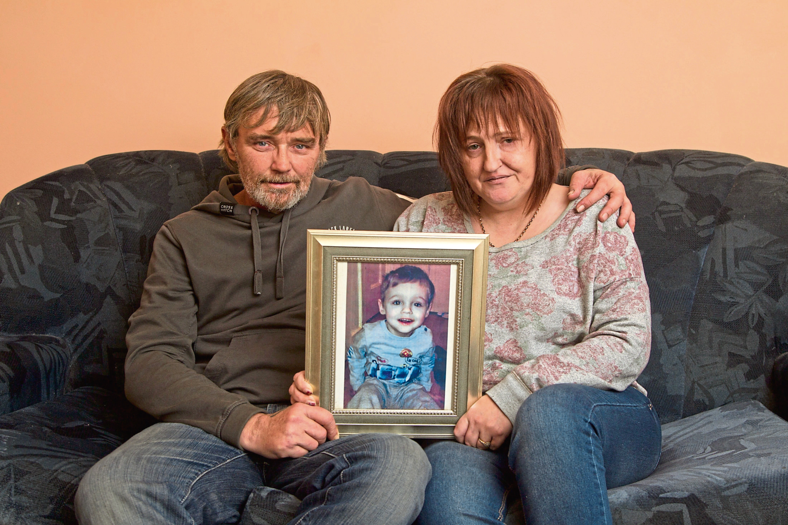 Wayne Forte and Leanne Smith with a photo of their son. Leanne has since passed away.