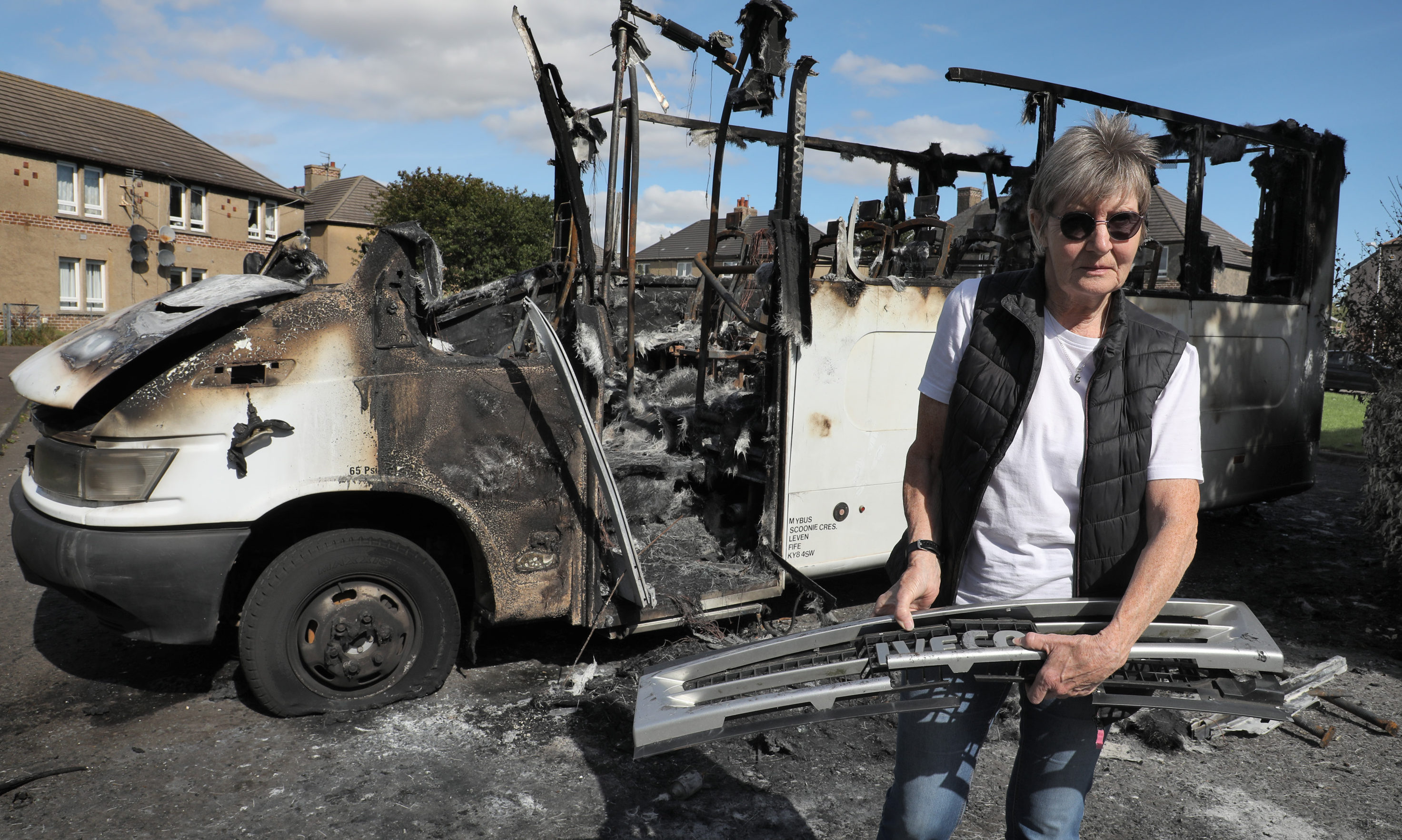 Mary Parry with the burnt out minibus in Methil.