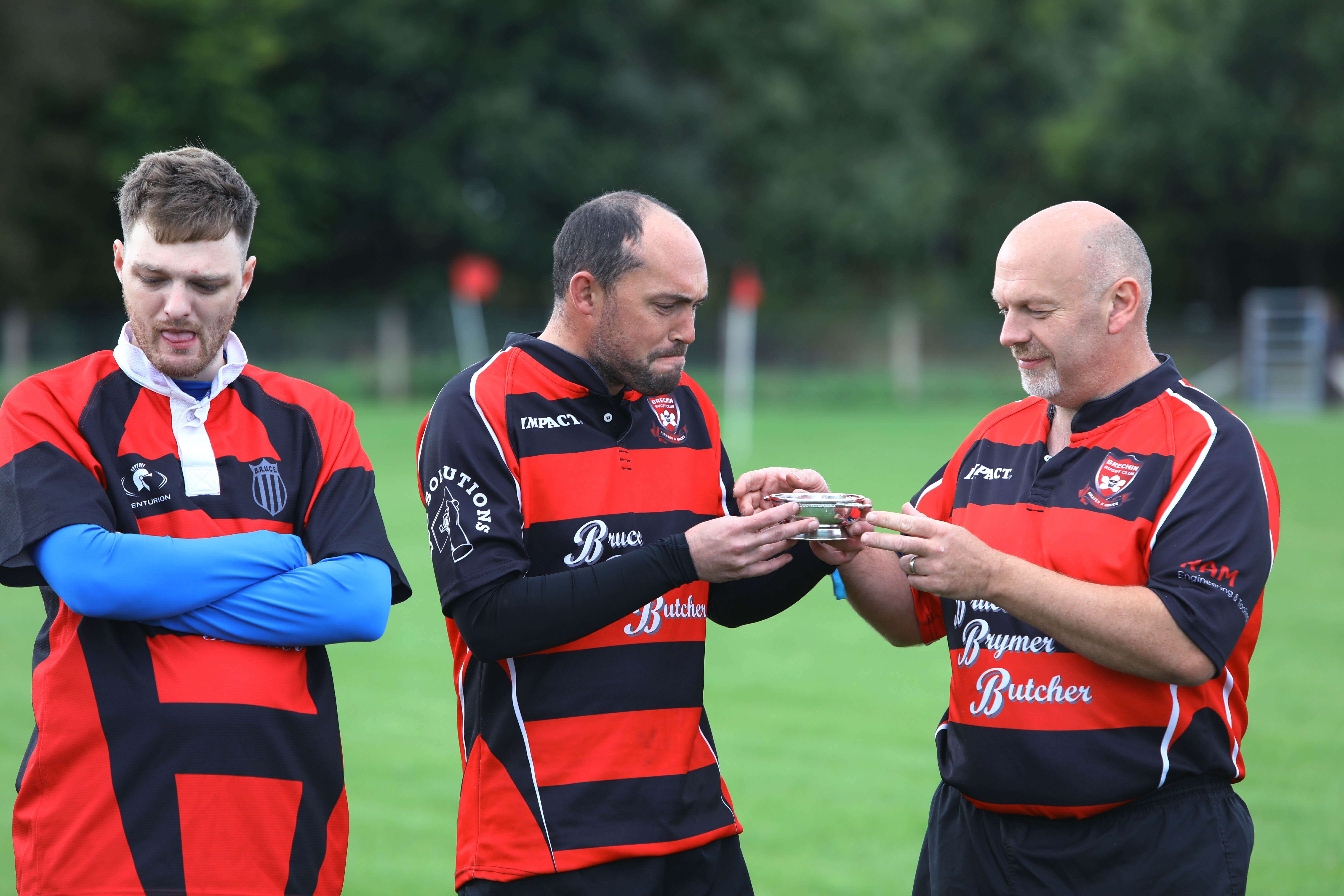 Players take a drink of whisky from the quaich, before the first game on the new Brechin Rugby Club pitch.