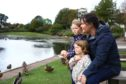 Kirsty Napier with her daughters Esther, age 4 and Brooke, age 3, looking out for the elusive 'Keptie Hand' at Keptie Ponds in Arbroath.