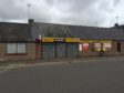 The boarded-up shop in Montrose Street, Brechin.