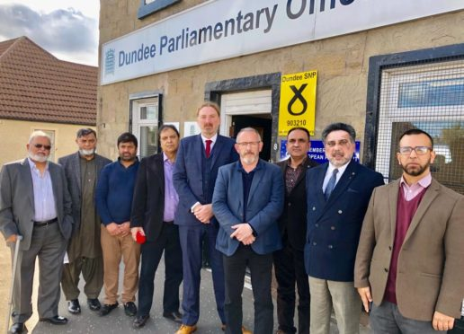 Mr Law and Mr Hosie with members of the Dura Street Mosque.
