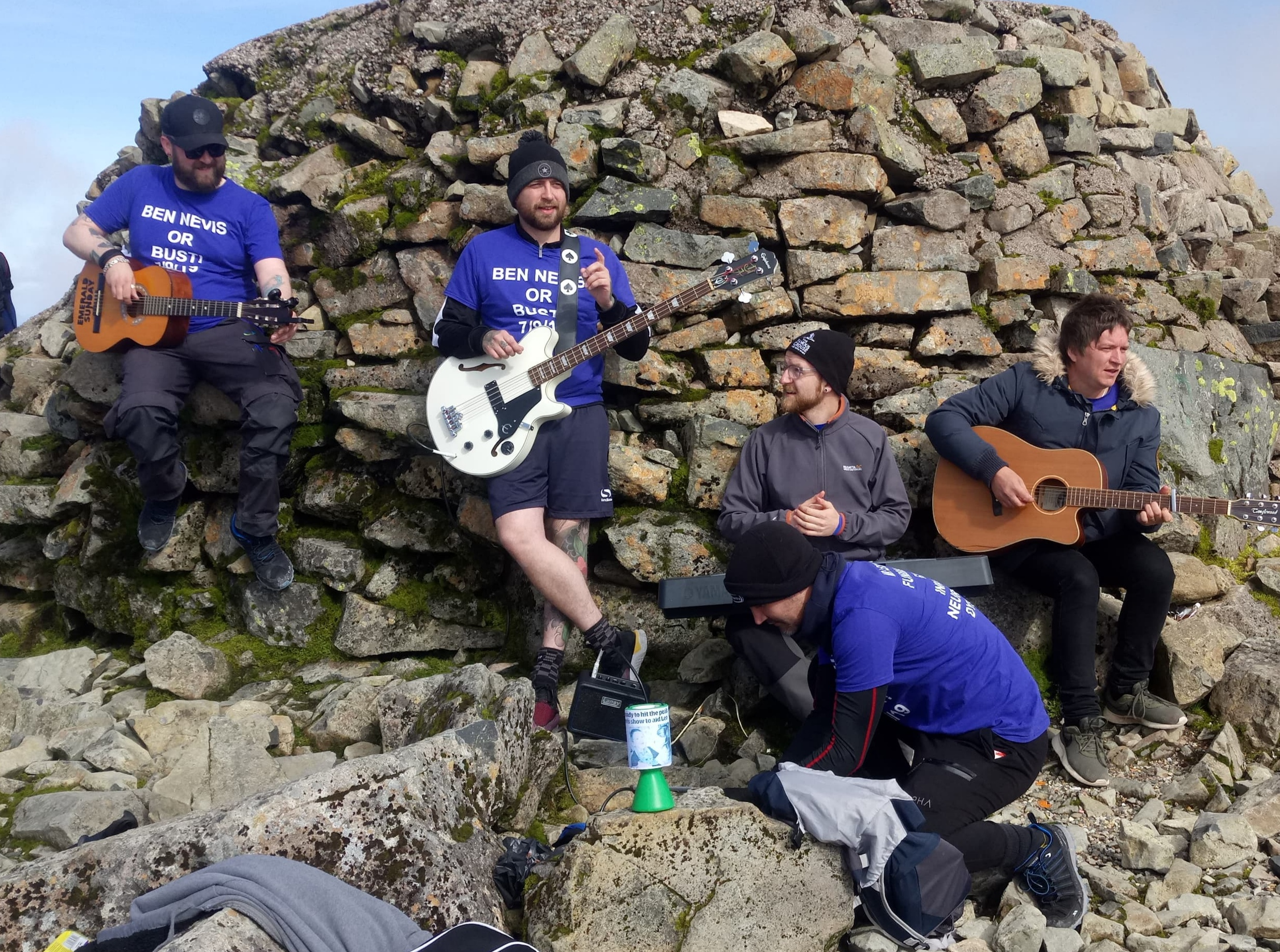 Emerald Sunday's Matthew Fleming, Scott Crawford Andrew Taylor, singer Mike Martin and Alan Hunter on the summit of Ben Nevis.