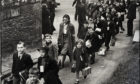Ancrum Road, Dundee school children on way to Lochee Railway station for evacuation