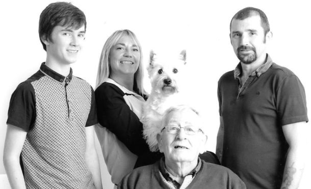 Most recent family image of Stewart's grandson James, Jeanie holding Blue the dog, Jeanie's partner Anthony and Stewart.