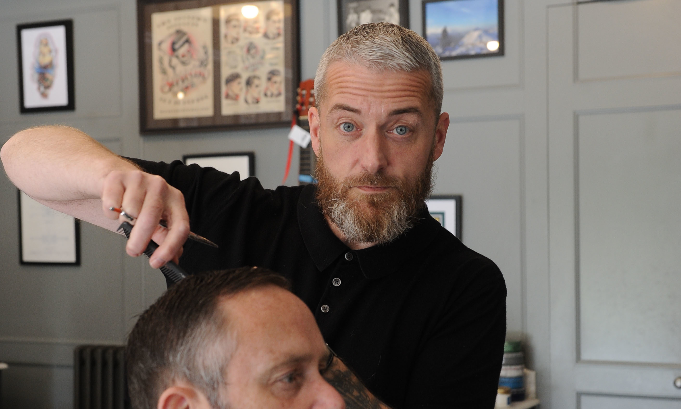 Barber Brian Jobson at his barber shop in Dunfermline.