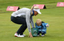 Suzann Pettersen with her son Herman on the driving range at Gleneagles.