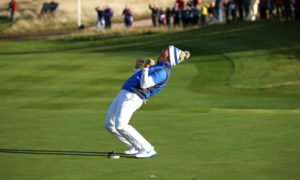 Team Europe's Suzann Pettersen celebrates her putt on the 18th that won the Solheim Cup.