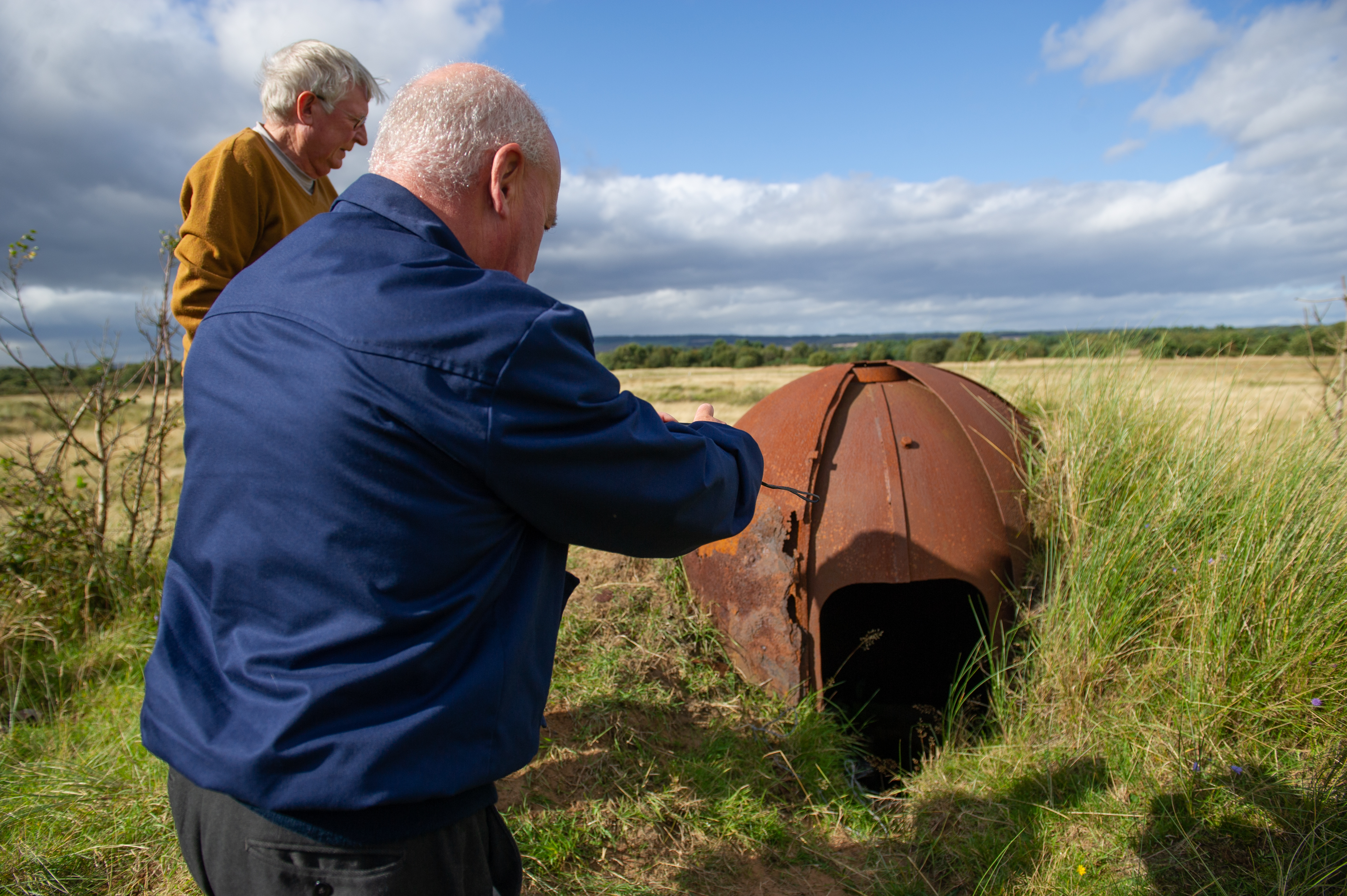 Carnoustie Legion members examine the turret that has also been unearthed.