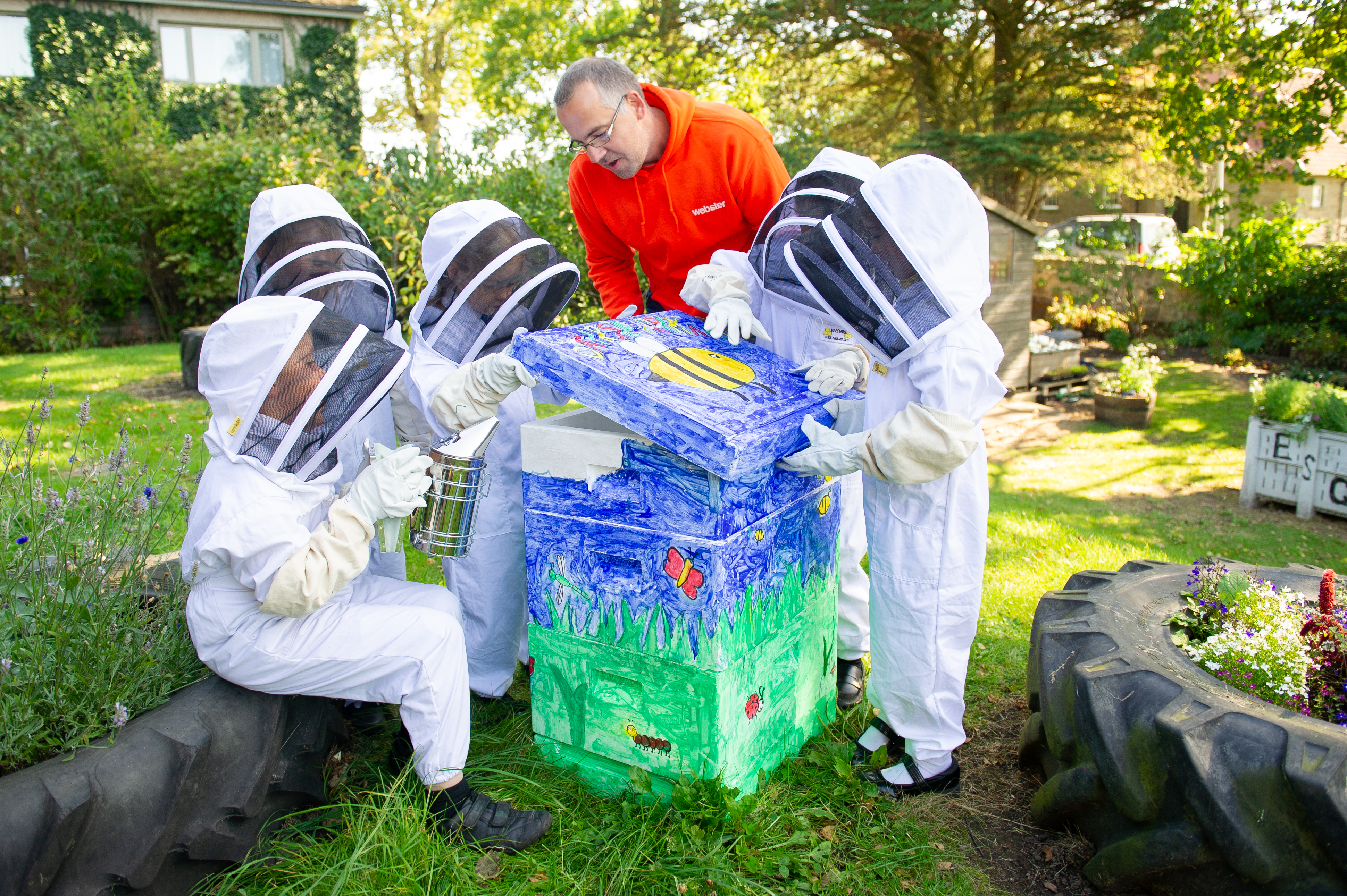 Dairsie primary pupils with their bee hive.  L to R - Louis Wainwright, Sophie Reid, May Hain, Meik Molitor of Webster Honey, Elliot Lawrence and Jennifer Rodriguez.