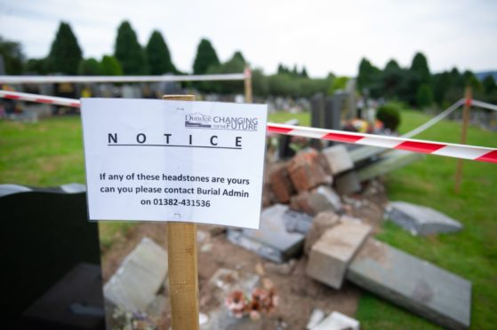 The council advisory notice left at the damaged headstones at Balgay Cemetery in August.