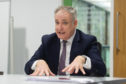 Richard Lochhead speaking to students in Dundee on Tuesday.