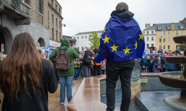 A protester wrapped in a Brexit flag outside Dundee City Chambers in September 2019.