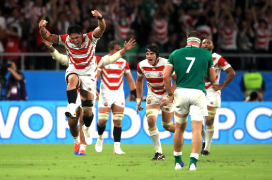 Japan's players celebrate their victory over Ireland.
