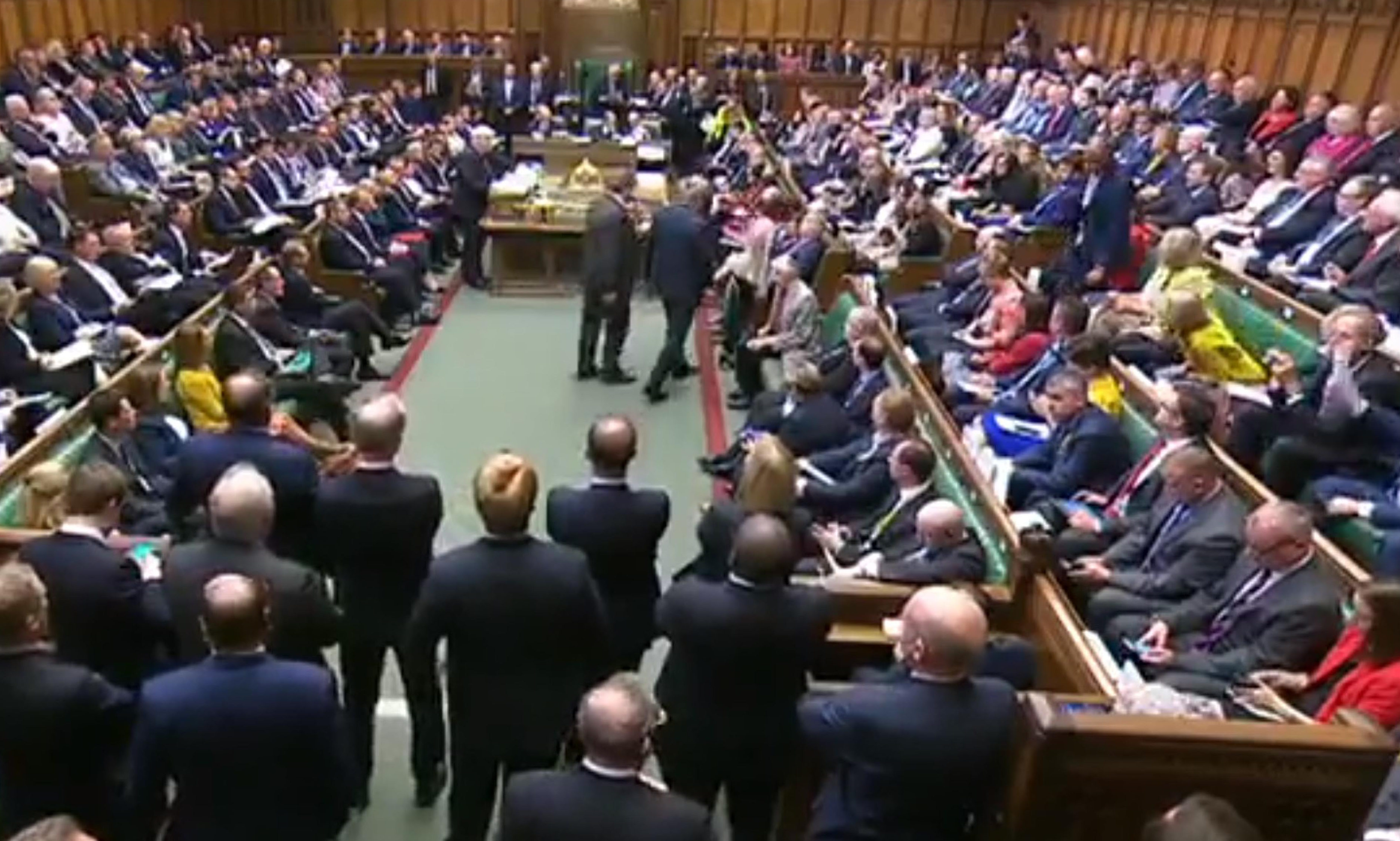 Phillip Lee (centre standing right) takes his seat among Liberal Democrat MPs as Prime Minister Boris Johnson makes a statement to MPs in the House of Commons, London, on the G7 Summit in Biarritz.