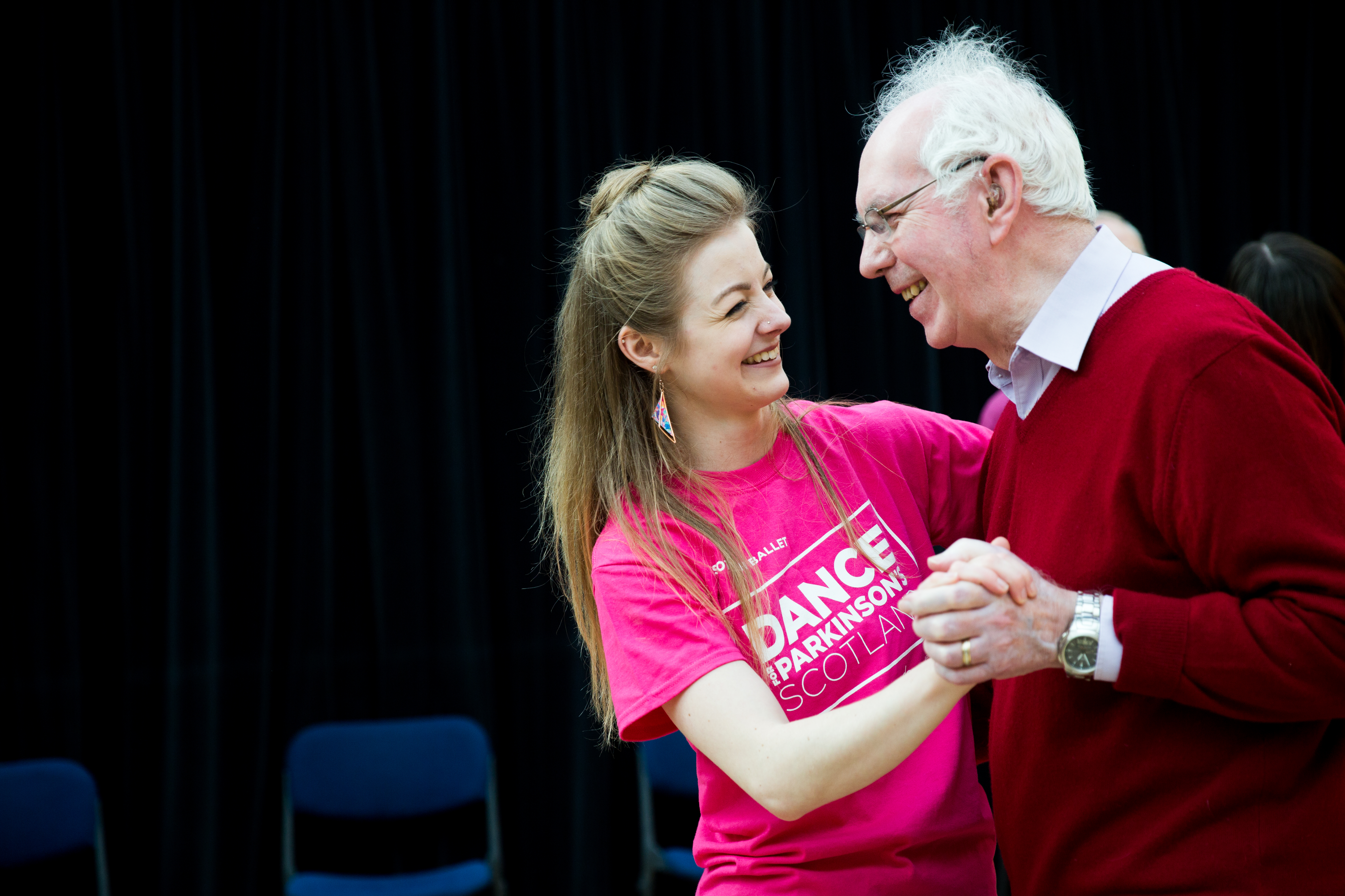 A dance tutor with a participant.