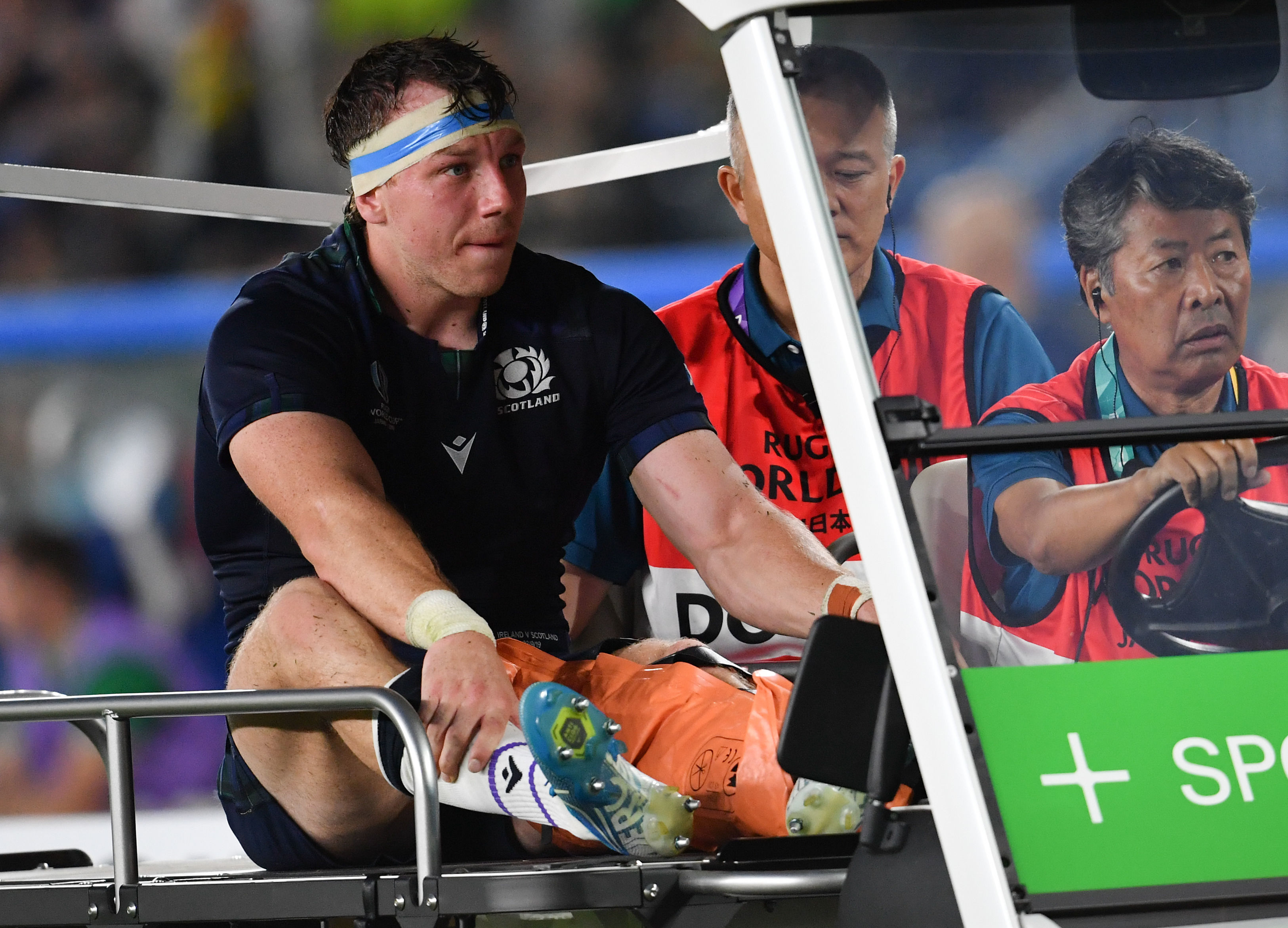Scotland's Hamish Watson is driven off injured during Sunday's game.