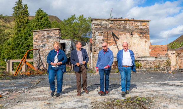 Murdo Fraser, second from left, has called on Perth and Kinross Council to step in and take control at the Spittal of Glenshee Hotel site.