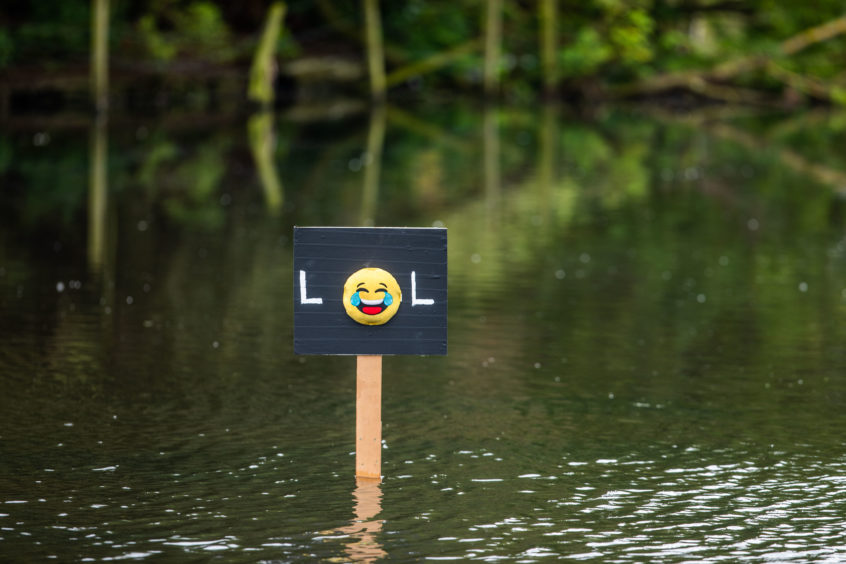 The Keptie Pond statue in Arbroath ponds was replaced with a laughing emoji sign.