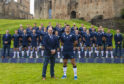 Scotland head coach Gregor Townsend and captain Stuart McInally pose in front of the squad during an announcement of the Scotland squad for the Rugby World Cup.