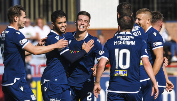 Cammy Kerr, centre, celebrates his goal on Sunday.
