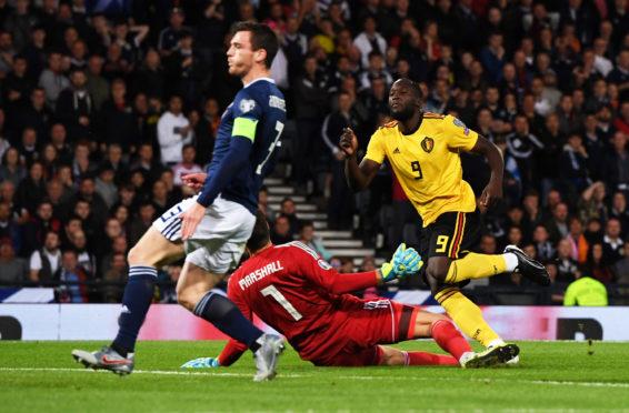 Romelu Lukaku scores against Scotland.