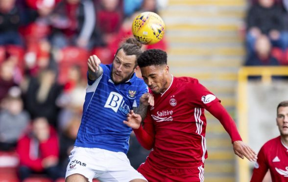 Stevie May battles for the ball with Abrdeen player Zak Vyner.