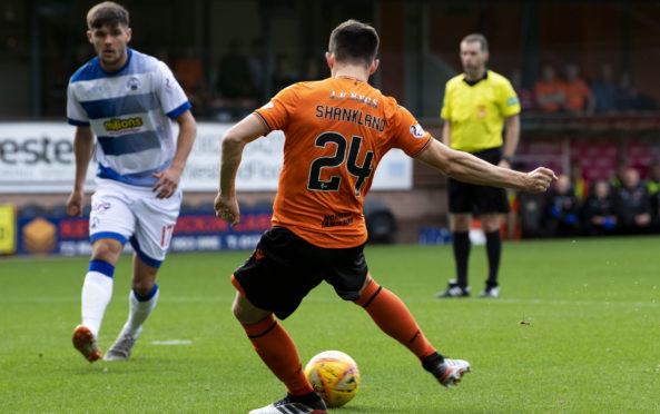 Lawrence Shankland gets ready to make it 1-0.