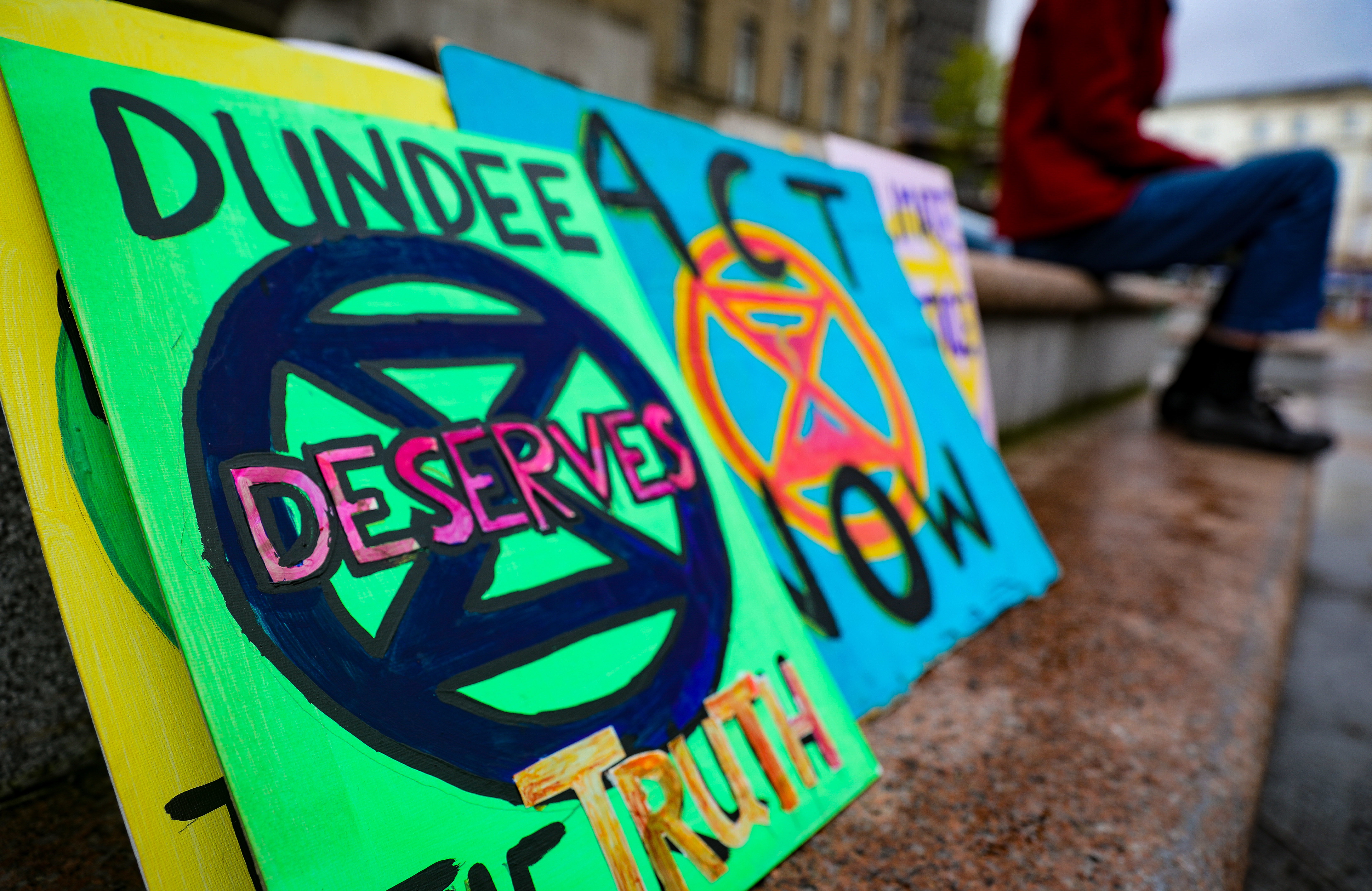 Banners and flags from a climate change protest in Dundee in September 2019.