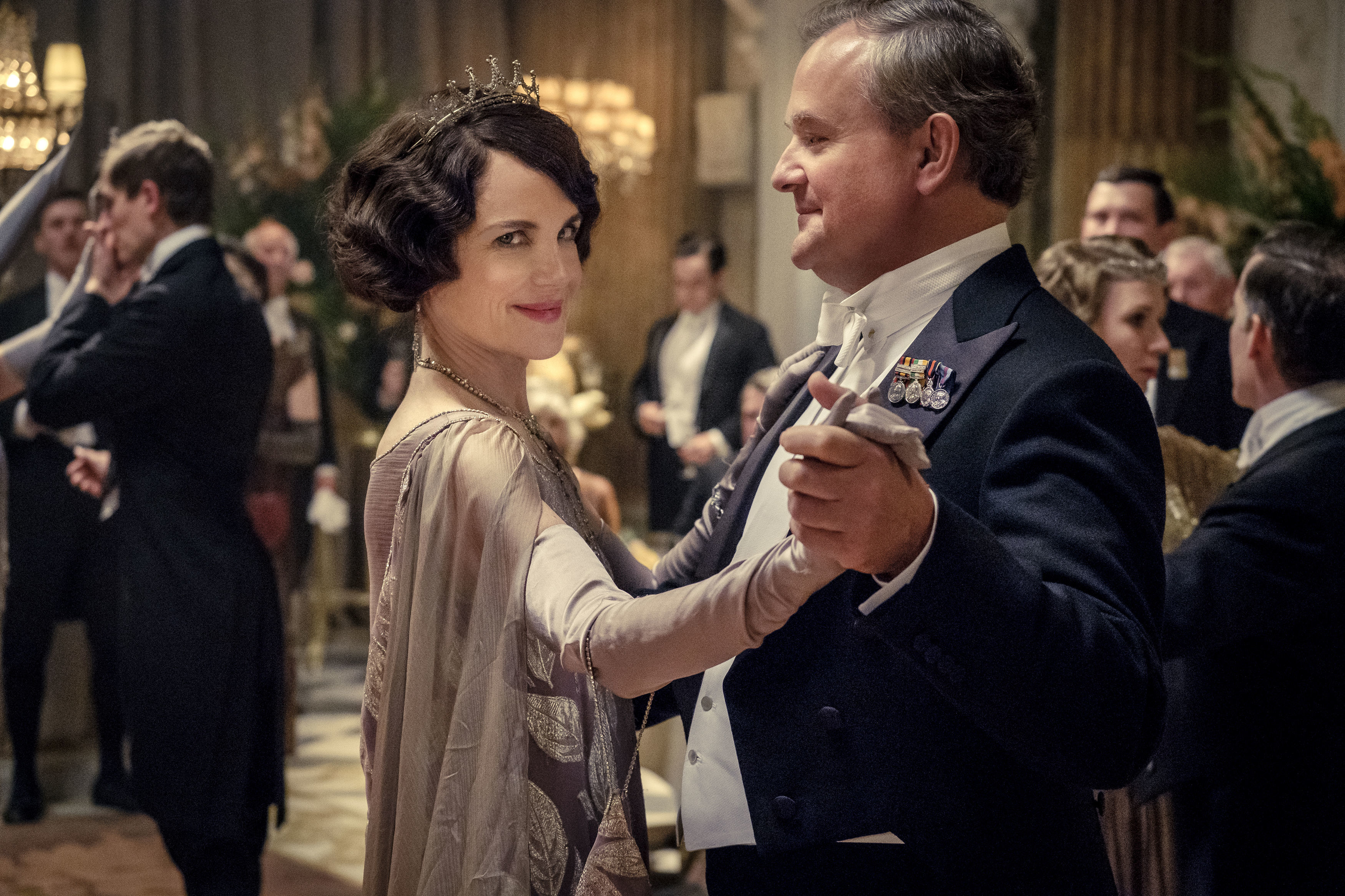 """This image released by Focus Features shows Elizabeth McGovern, left, as Lady Grantham and Hugh Bonneville, as Lord Grantham, in """"Downton Abbey"""". The highly-anticipated film continuation of the ÒMasterpieceÓ series that wowed audiences for six seasons, will be released Sept. 13, 2019, in the United Kingdom and on Sept. 20 in the United States. (Jaap Buitendijk/Focus Features via AP)"""