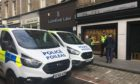 Police outisde Walkers Luxury Jewellers in Union Street, Dundee, on Monday September 23.