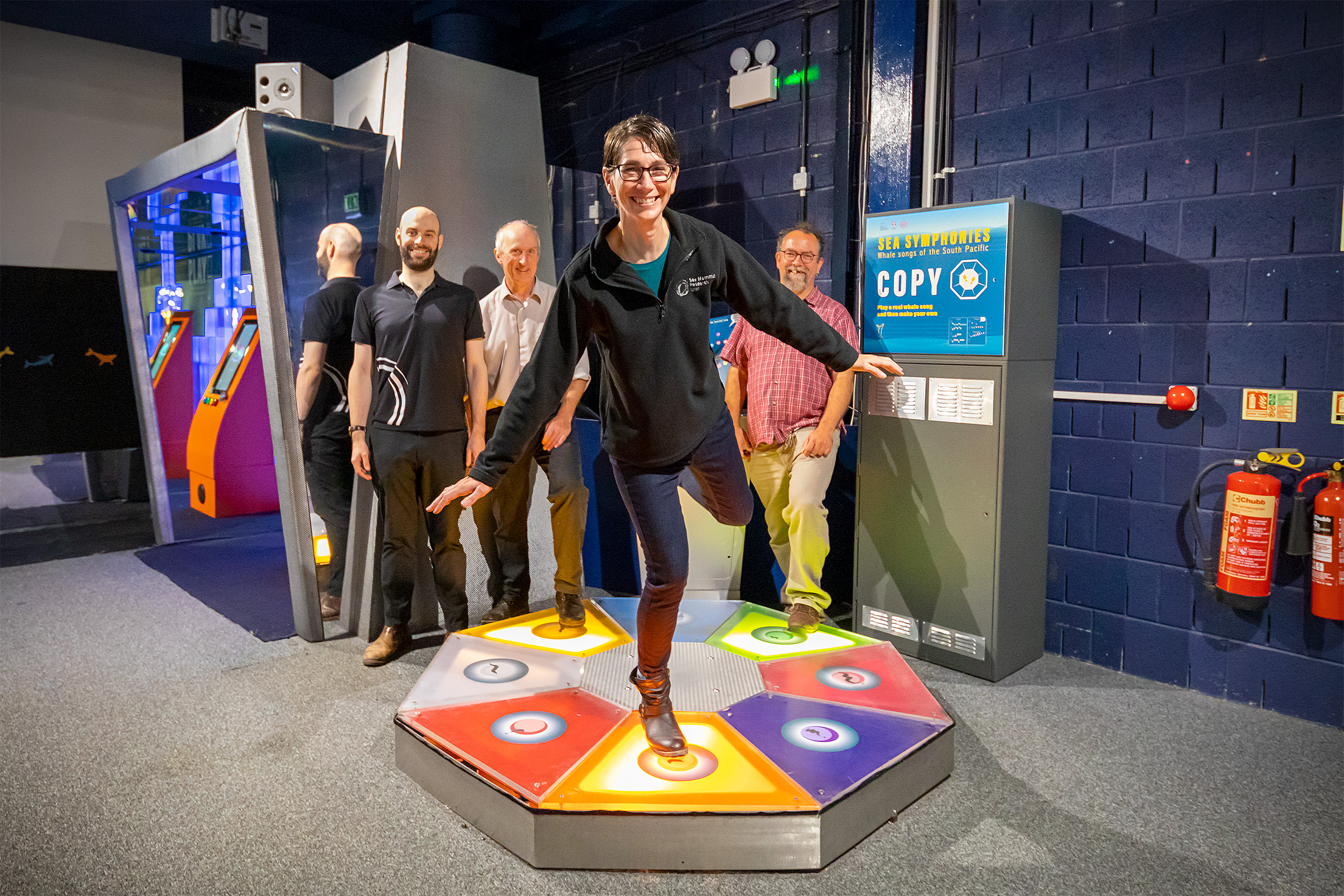 Dr Ellen Garland from St Andrews University tries out the exhibit. In the back row are Matt Williamson from Dundee Science Centre and the university's Steve Smart and Dr Luke Rendell.