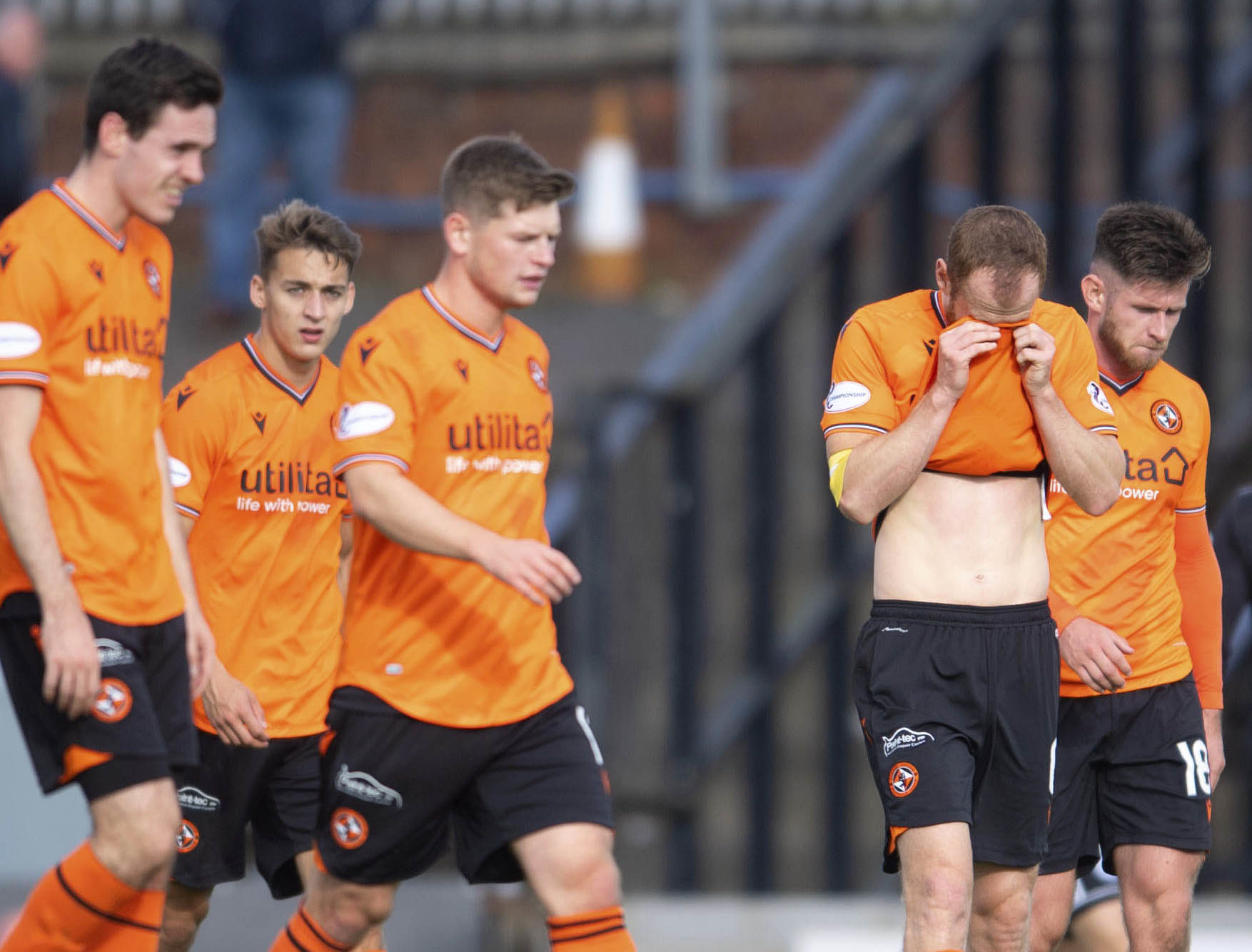 Dejected Dundee United players at full-time.