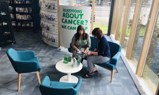 Jackie Brown, Macmillan volunteer co-ordinator at ONFife Libraries, left, with Carolyn Johnston, facilities and service supervisor at Lochgelly Centre, in the Macmillan space at Lochgelly Centre.