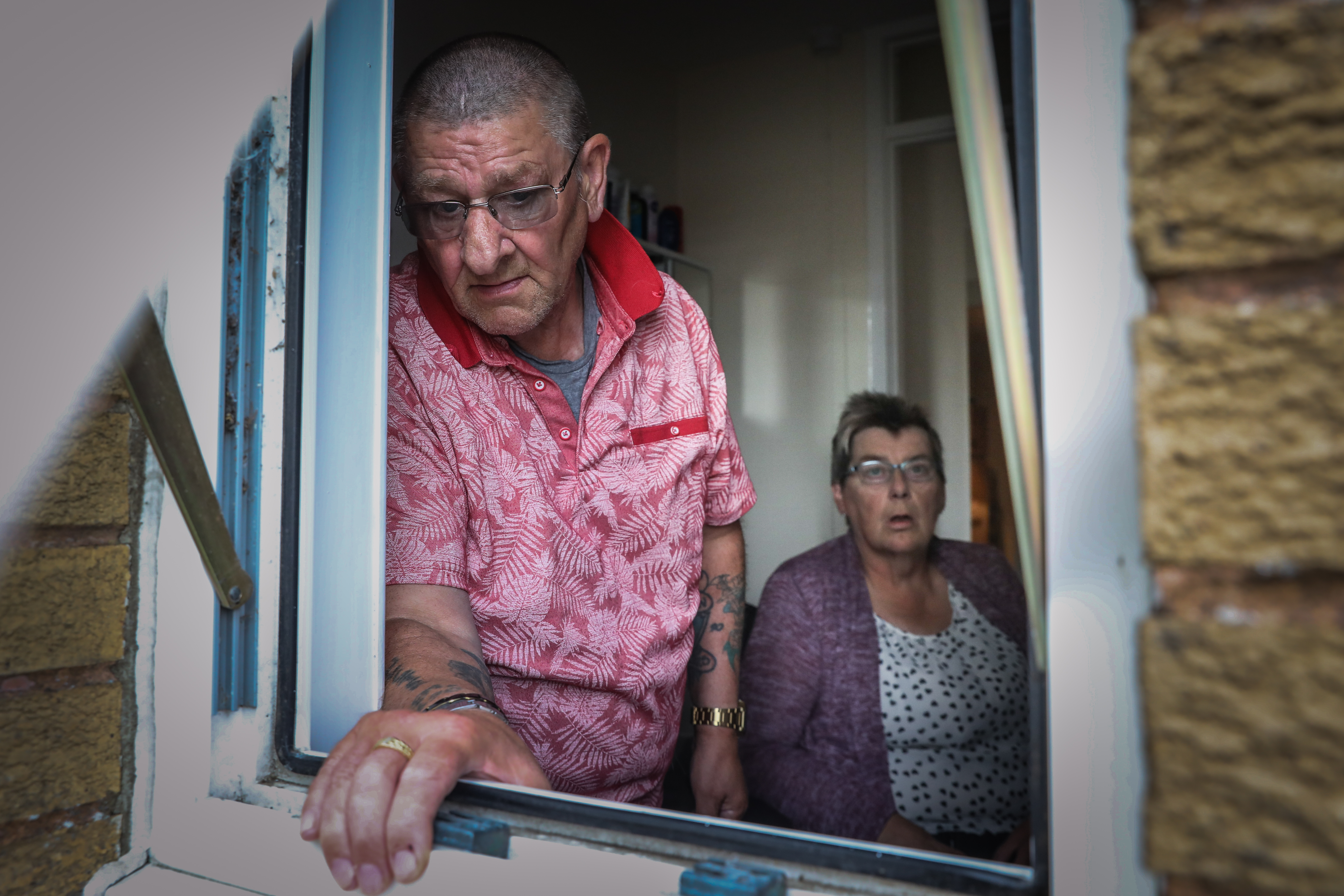 Alister Gillon and Eunice McIntosh beside the bathroom window where the thieves broke in.