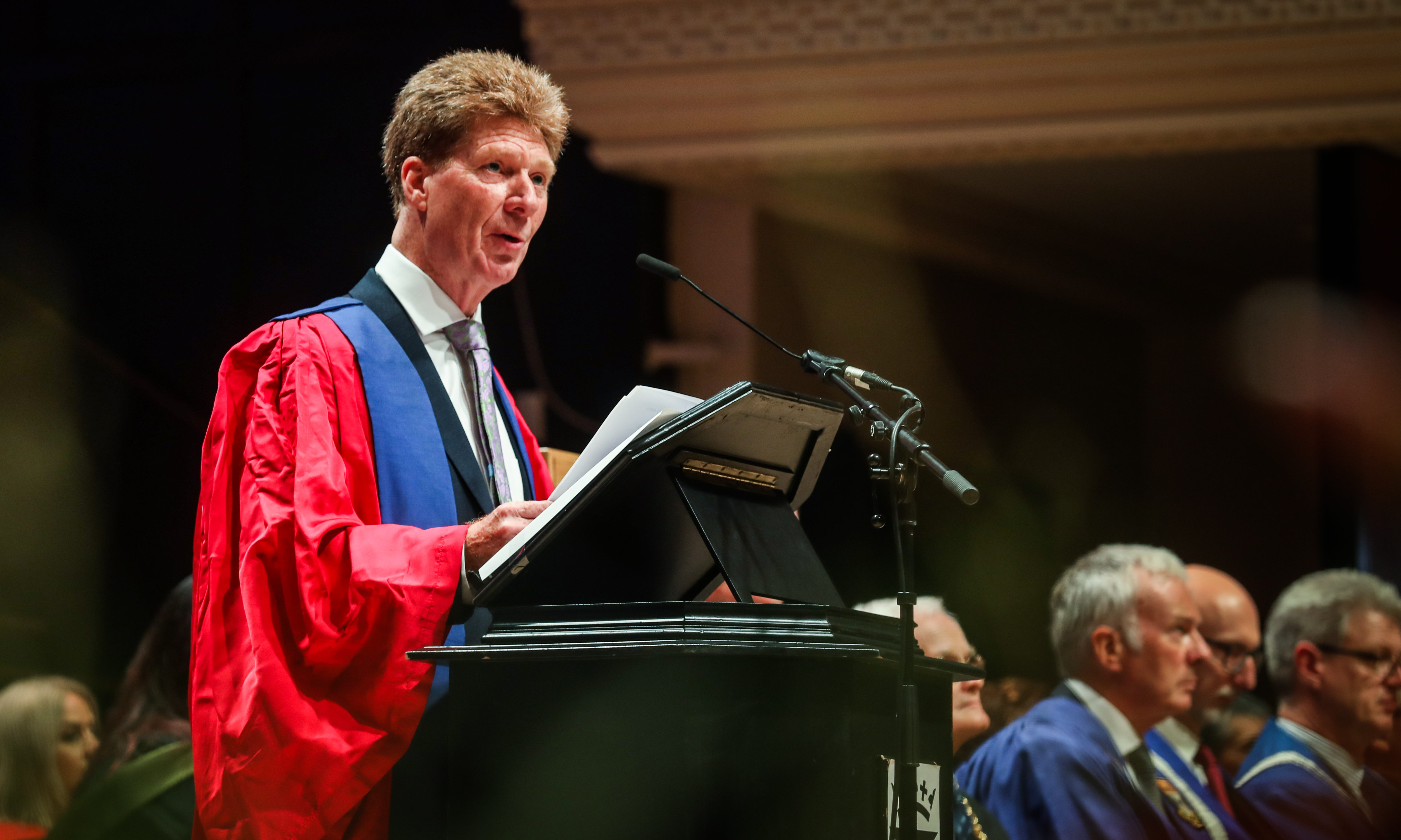 Jim Spence on stage making his address as he is officially named Dundee University rector.