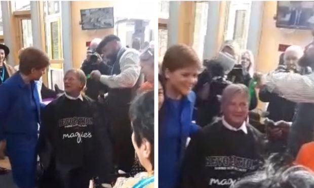 David Torrance getting his hair cut in Holyrood.