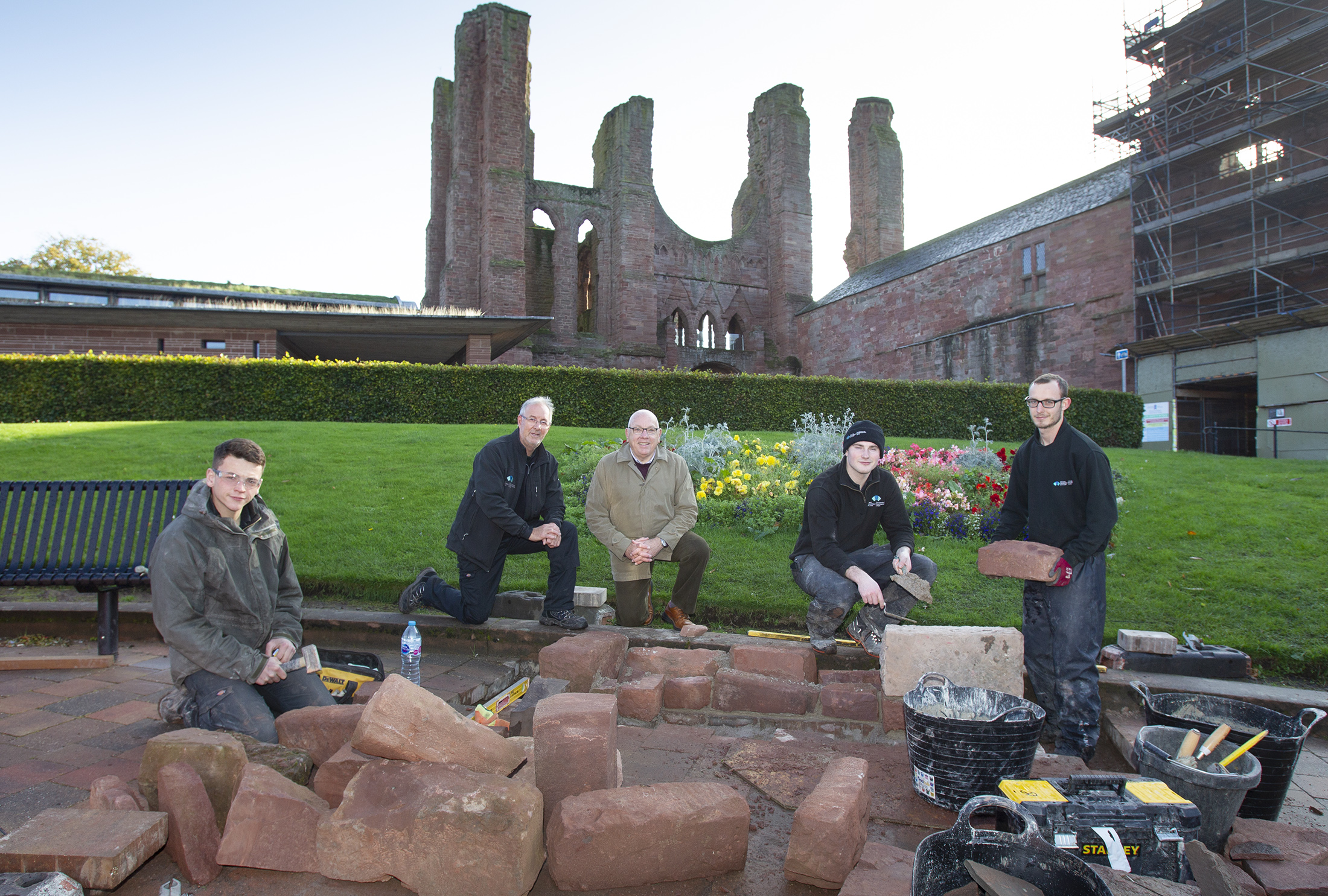 James Robertson.(2nd from left).. Historic Environment Scotland's Works Manager alongside  Ian Ballantyne(3rd from left) past Dean of Arbroath Guildry. also pictured are Historic Enviroment Scotland apprentices L to R: Liam Macaulay, Luke Maher, Douglas Stevens
