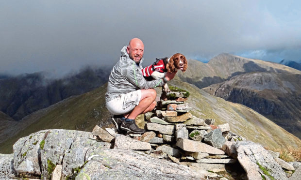 Spaniel Genghis and owner Mac Wright climbed all 282 Munros.
