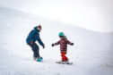 Skiers and snowboarders enjoy the snow at Glenshee in March.