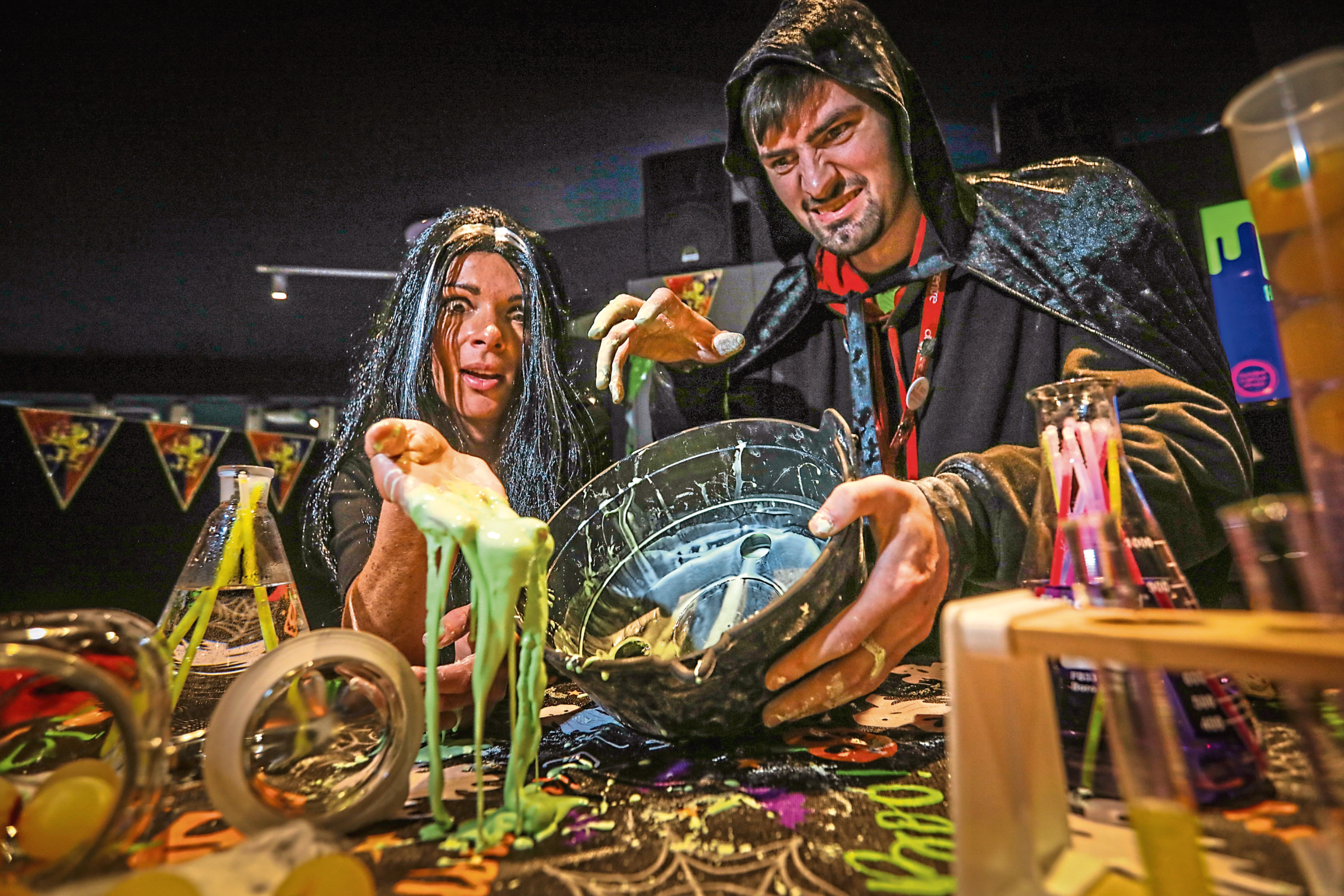 Gayle, aka Witchy Ritchie, gets messy with slime with science communicator Michael Maitland.