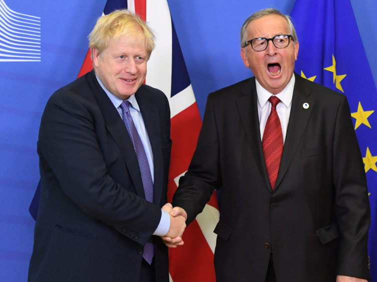 Prime Minister Boris Johnson and President Jean-Claude Junker at the summit in Brussels on Thursday
