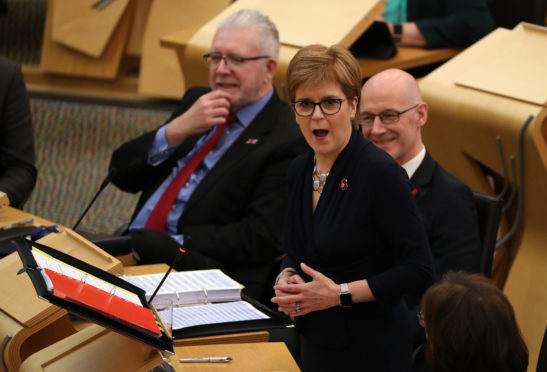 First Minister Nicola Sturgeon in the debating chamber during FMQs at the Scottish Parliament in Edinburgh.