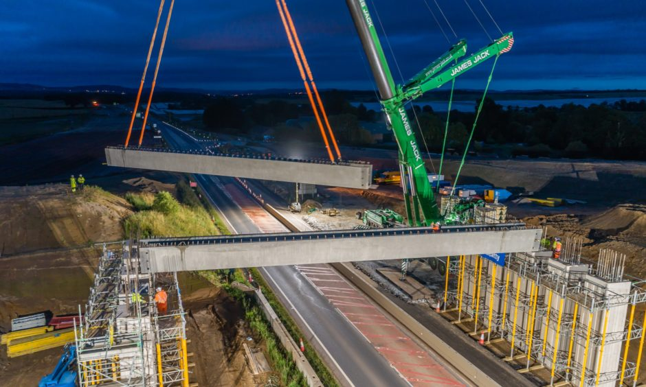 Beams being swung into place over the A9 at Tullybelton.